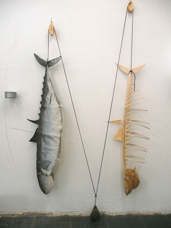 Kala kuivalla maalla, H180, W110, D22 cm, wood, paper, tin of tuna, steel, string, 2014