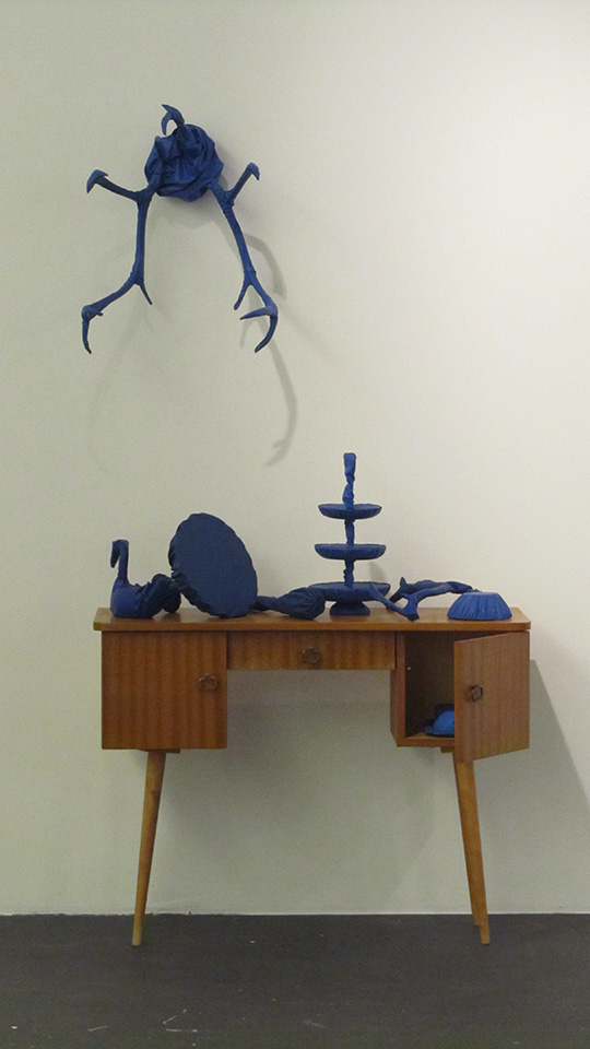 Feeling blue, 2014, installation. Mixed media: metal, alpaca, reindeer antler, brass, copper, plastic, children's dungarees, bear thread and a dressing table.