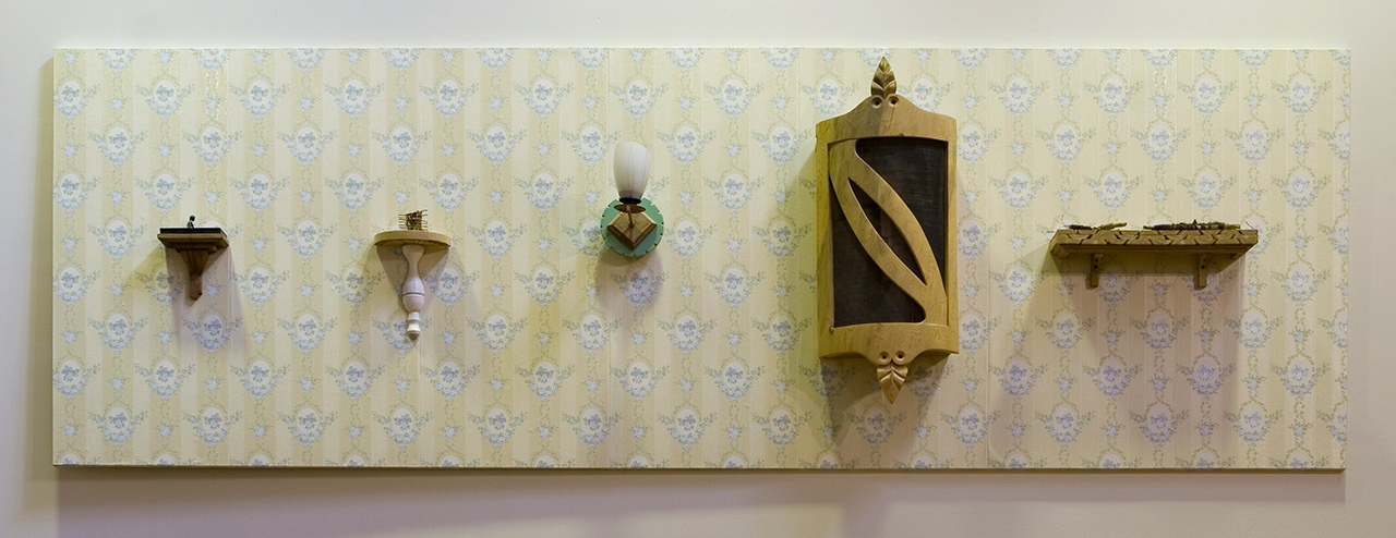 Tom Engblom: Unelmia. 1995-98. Assemblage, wallpaper, wood, objects. 120 x 360 x 20 cm. University of Lapland, Rovaniemi; library frieze.